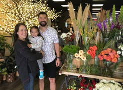 On grand opening day, the Guenther family smiles inside their brand new showroom