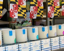 Maryland flags and Annapolis candles on display in our showroom